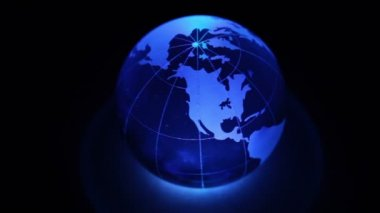 Sphere spins with world map on it and color illumination — Stock Video