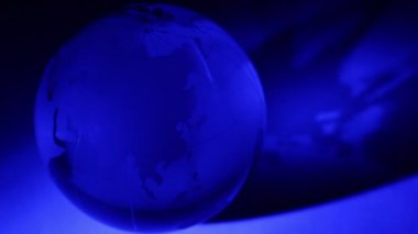 Glass Earth sphere spins with blue color illumination — Stock Video