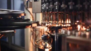 Workpiece of PET bottles move after warm up at factory — Stockvideo