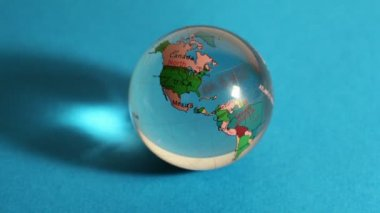 Red light flashes on transparent sphere with world map on it — Stock Video