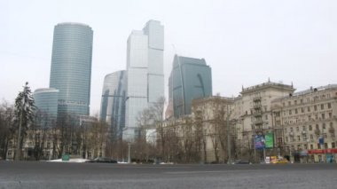 Cars goes on prospectus before center Moscow City and Stalin house stand on right — Stock Video