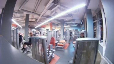 People train in gym in Fitness center TerraSports - Iridescent — Stock Video