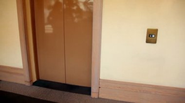 Automatic doors opens and little boy comes out from elevator — Stock Video