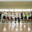 Many students archers stand in shooting gallery on IV Traditional archery tournament in RSUPES&Ton — Vídeo Stock