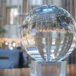 In glass ball is reflected business center hall — Stock Video