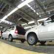 Stock Video: Cars are move on pipeline in assembly shop on plant AUTOVAZ