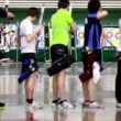 Many young sportsmens archers stand in shooting gallery — Stock Video