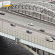 Cars quickly go on Andreevsky bridge on multilane highway — Stock Video