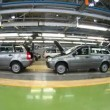 Stock Video: Workers do car complete set in assembly shop