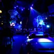 Car standin dark night club with colorful illumination — Stock Video