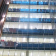 Stock Video: In windows of business center is shone light on stages indoors