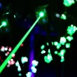 Stock Video: Four lasers hang under ceiling and emit rays