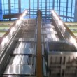 Two elevators go to business-center where light in windows of offices is shone — Stock Video
