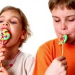 Two kids boy and girl eat lollipops  — Stock Video