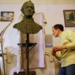 Stock Video: Sculptor Denis Petrov use clay to correct unfinished A.Suvorov bust