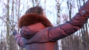 Young woman circling at background of birches — Stock Video