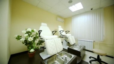 In cosmetology room for pedicure in beauty salon there are two special seats — Stock Video