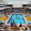 People have rest on spacious deck of ship, swimming in pool — Vidéo