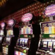 Row of play machines with blinking illumination in casino — Stock Video