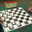 People play checkers with time limit, and then girl cames — Stockvideo