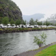 Stock Video: Camping on shore of river which flow into fiord near mountain