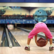 Little girl in pink clothes play bowling and jumps — Stock Video #32341305