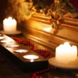 Burning candles and beads face mirror in carved frame in dark — Stock Video