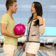 Two students stand and talk near bowling lane in club — Stock Video