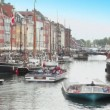 Excursion motorboats at Nyhavn canal in Copenhagen, Denmark — Stok Video #32341549