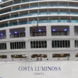 Feed of huge multideck Costa Luminosa liner standing at coast — Stock Video