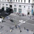 People pass Gran Via Square on crosswalk — Stock Video