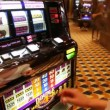 Young woman hazardous plays in club on amusement machines — Stock Video