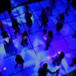 Stock Video: Lot of kids dance at discotheque in dark club, view from above