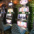 Number of slot machines with empty chairs in casino — Stock Video