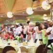 People dance among tables in restaurant on ship during cruise — Stock Video