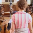 Mother with two kids walk near row of benches in cathedral — Wideo stockowe