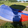 Shadow falls on grass from flying balloon of club of aeronautics — Stock Video