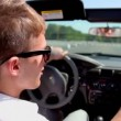 Student in sunglasses ride drive cabriolet by street — Stock Video