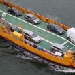 Automobiles and passengers on deck of ferry boat float in sea — Video