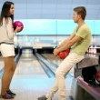 Girl throws bowling ball, boy raises hands satisfied with result — Stock Video