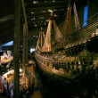 Stern of old tall ship and tourists walk on Vasa Museum — Stock Video