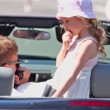 Couple and girl sit in cabriolet, boy talk by hand radio — Stock Video