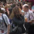 Stock video: Womin mask inflates soap bubbles in crowd of people
