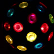 Electric light sphere spins with different colors heliofilters — Stock Video