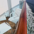 Stock Video: Two chairs and table at balcony on vessel which floats in sea