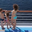 Mother, daughter and son look at water on board ship — Stock Video
