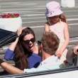 Couple sit and smile in cabriolet and kids, then they ride away — Stock Video