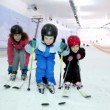 Mother with her kids stand on ski and sway — Stock Video