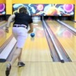 Young guy throws bowling ball and beats all skittles — Stockvideo