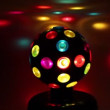 Electric light sphere spins and colorful spots move around it — Stock Video